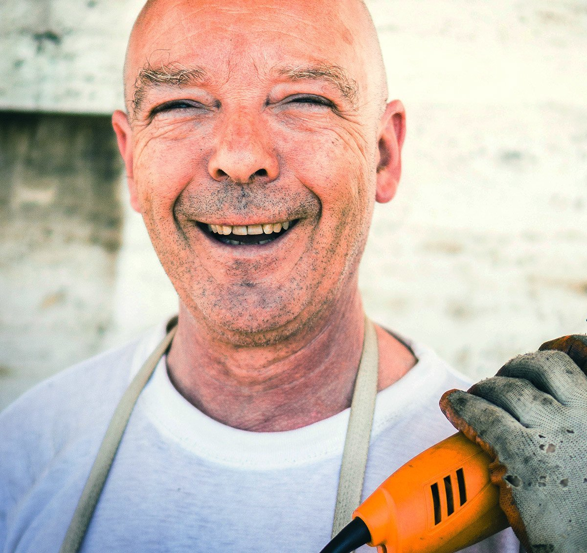 smiling man with tool