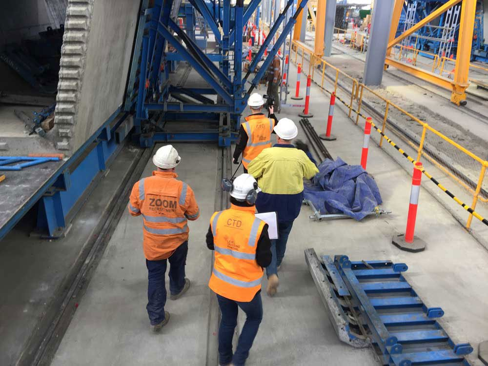 workers in hard hat and vests using real-world solutions on the job