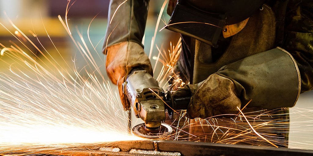 sparks fly as man grinds metal